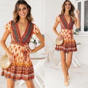 boho orange surplice v neck wrap mini dress